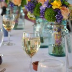 Wedding Wine glasses on a table with flowers